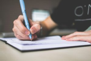 Man making notes on his Will_Why should I write a Will_Body Image | Remember A Charity