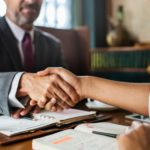 A solicitor shaking hands with a client