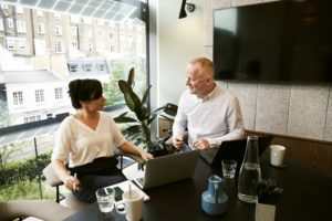 A man and a woman discussing a Will in an office