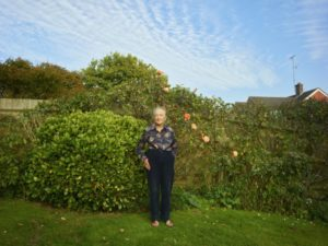 A photo of Pat in a garden