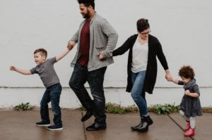 A photo of a family walking down a pavement | Remember A Charity