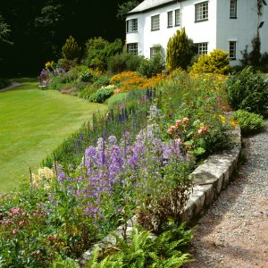 A photo of a house and a garden | Remember A Charity
